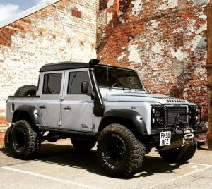 Silver and black Land Rover Defender
