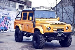 Yellow Land Rover Defender